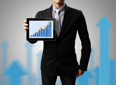 Businessmen, hand pointing on touch screen graph on a tablet photo