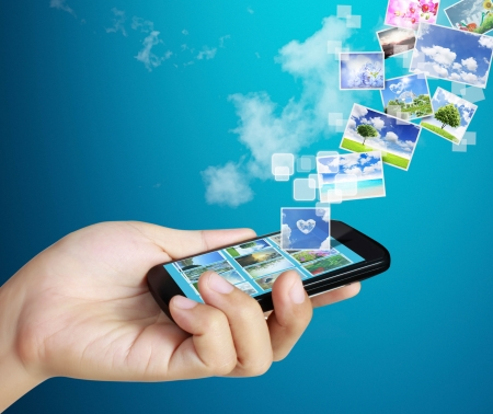 ringtones: Touch screen mobile phone in hand Stock Photo
