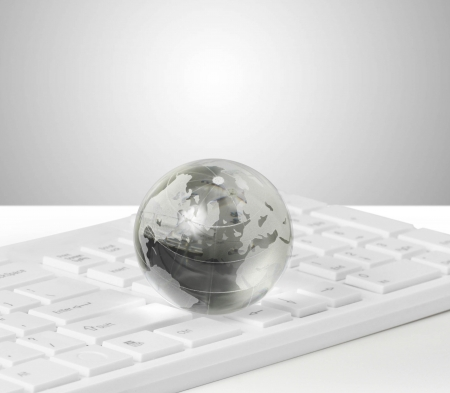 concep: globe and keyboard showing global communication or internet concep