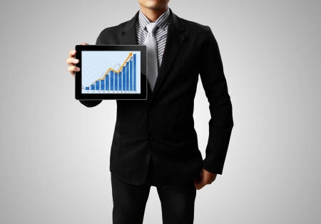 Businessmen, hand  touch screen graph on a tablet Stock Photo - 14181035