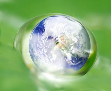 earth  in waterdrop reflection on green leaf