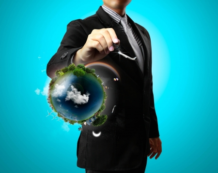 Business man drawing air and earth photo