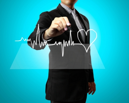 Business man Hand drawing health,heart photo