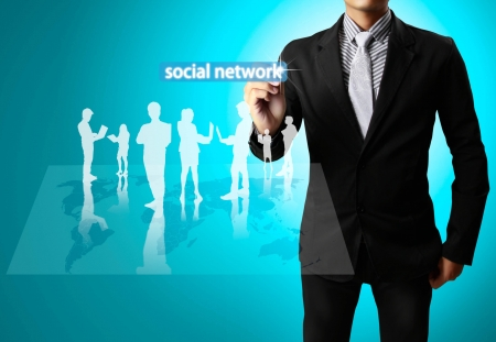Business man drawing social network structure photo