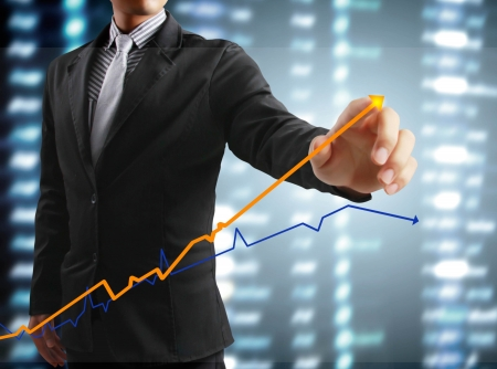 Businessman and touching display screen with statistics graph and data informations photo
