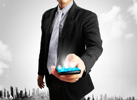 mobile sms: Touch screen mobile phone with businessmen Stock Photo