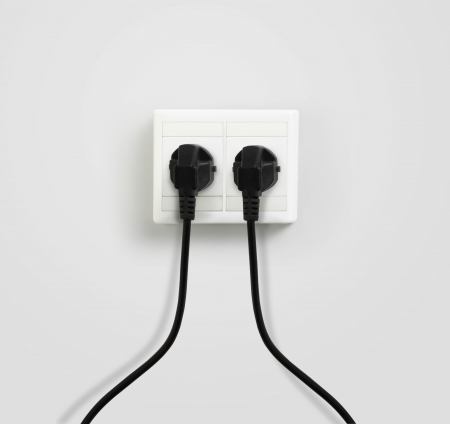 plug plugged in a socket photo