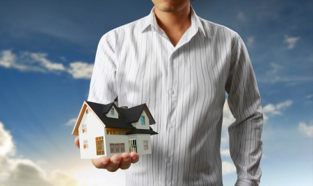 partment: house in human a hands with businessman