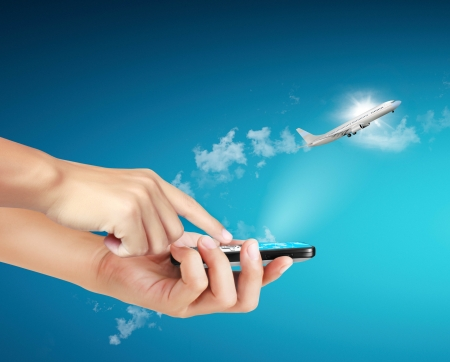 Touch screen mobile phone, in hand and aircraft photo