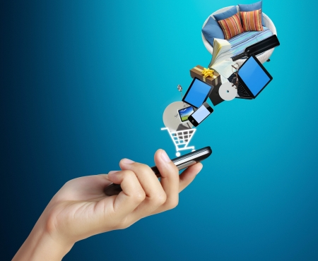 mobile shopping: Touch screen mobile phone, in hand and globes Stock Photo