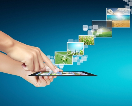 telecommunication: touch tablet concept images streaming from in hand