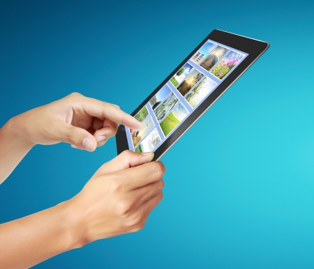touch tablet concept images streaming from in hand photo
