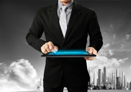 touch-tablet in hands with businessman photo