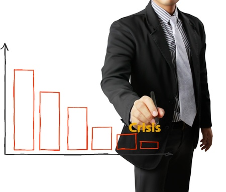 Business man hand drawing crisis a graph Stock Photo - 14419217