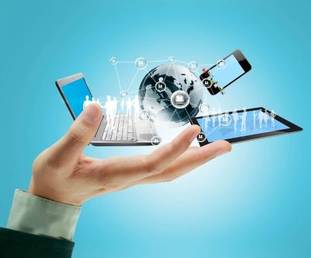 Technology in the hands of businessmen Foto de archivo