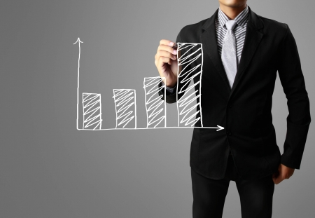 show business: Business man hand drawing a graph
