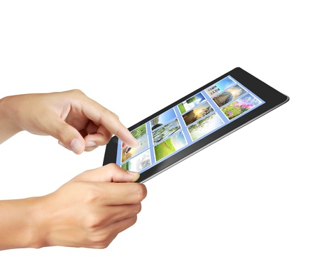 touch tablet concept images streaming in hand photo