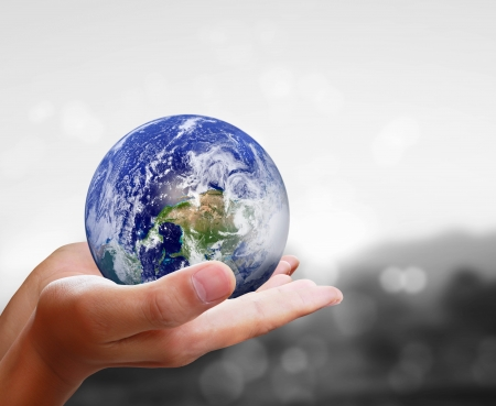 earth globe: holding a glowing earth globe in his hands