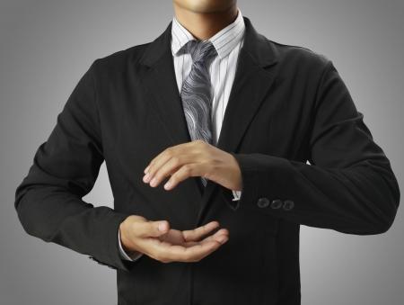 handsign: open hands of businessman Stock Photo
