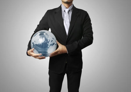 holding a glowing earth globe in his hands photo