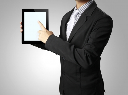Businessman pointing  touch screen tablet in a hand  photo