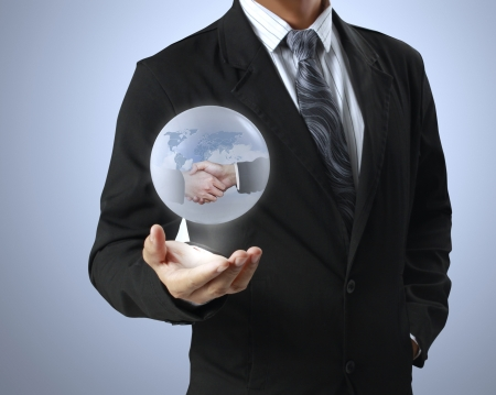 holding a globe in his hands  photo