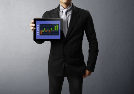Businessmen, and graph on a tablet photo