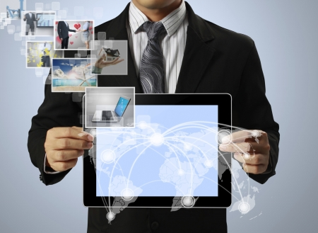 touch tablet concept images streaming from in hand Stock Photo - 14763372