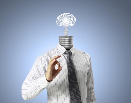 creativity: DEA концепция, бизнесмен осветительную головку Фото со стока