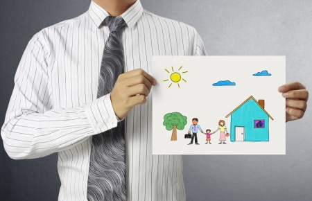 Business man handing house Paper over photo
