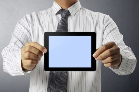 touchpad: Businessman holding a touchpad pc Stock Photo