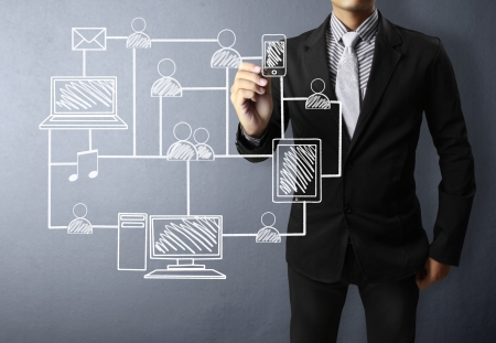 communication concept: Business man drawing social network structure  Stock Photo