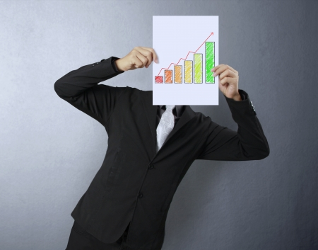 Business people standing with Graph on boards  photo