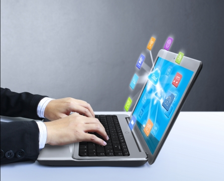 computer: business man holding a laptop  Stock Photo