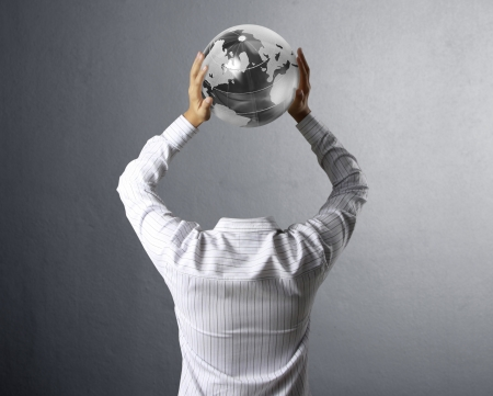 environment protection: holding a glowing earth globe in his hands
