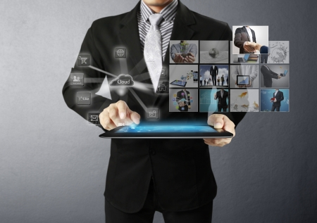 tablet pc in hand: Businessman holding a tablet pc