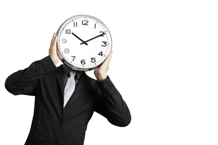 obscured face: Businessman with alarm clock on head  Stock Photo