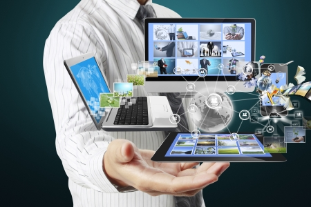 Technology in the hands of businessmen Stock Photo