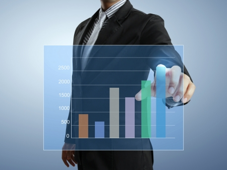 safe investment: Business men hand pushing write graph