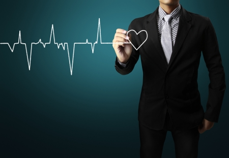 cardiovascular disease: Business man drawing a Hand