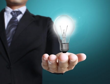 Light bulb, in a  hand Stock Photo - 16329970