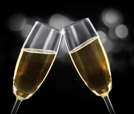 champagne flute: glass of champagne on black background Stock Photo