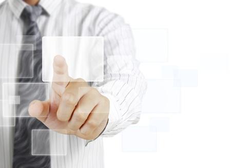 hombre empujando: Hombre de negocios que empuja en una interfaz de pantalla t�ctil Foto de archivo