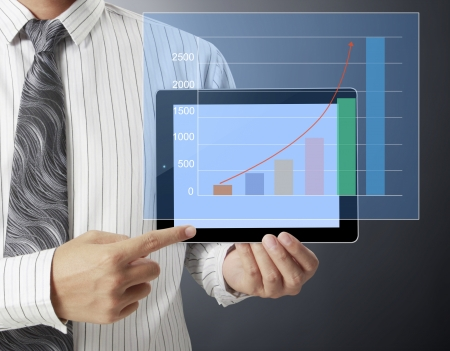 Businessmen, hand touch screen graph on a tablet  photo