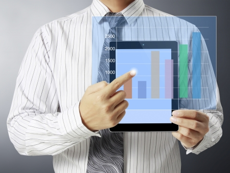 Businessmen, hand touch screen graph on a tablet  Stock Photo - 17785639