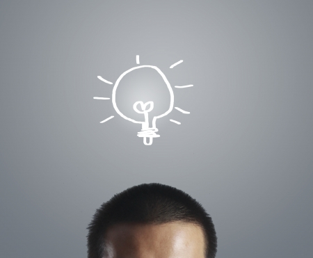 Businessman with an idea, drawn light bulb photo