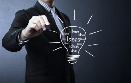 creative writer: Business man drawing light bulb  Stock Photo