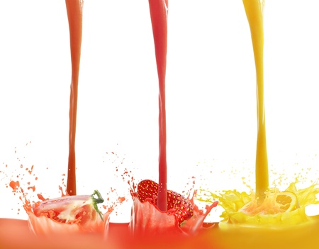 pours:  fresh juice pours from fruits on a white background Stock Photo