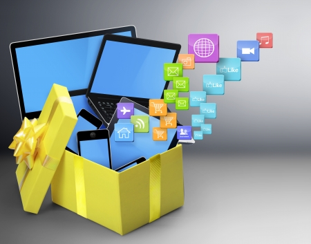 The group of mobile tablet devices and the open gift box Stock Photo - 18839523