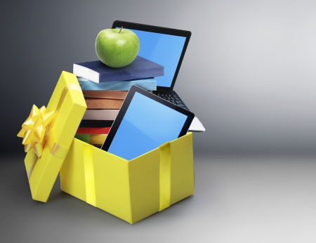 multitouch: The group of mobile tablet devices and the open gift box Stock Photo